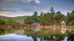 Indian Coastal Village - during pre monsoons (Nikhil.Hirurkar) Tags: sea river coastal june july maharashtra india canon 24105l green konkan monsoons bridge village people coconut trees reflection water 6d