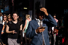 Oxford Circus (Gary Kinsman) Tags: london w1 westend oxfordstreet candid streetphotography streetlife light crowd shopping consumerism lateafternoon bright 2016 shades fujix100t fujifilmx100t shadow headphones iphone phones