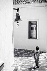 under the church bell (Faddoush) Tags: greece hellas cycklades kyklades church bell window boy