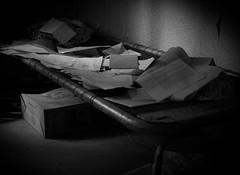 Left behind (markorsr) Tags: abandonedhouse bw monochrome blackandwhite mamiyam645 m645 bed papers mediumformat xtol11 xtol fomapan fomapan100 reciprocity 645 forgotten leftbehind abandoned letters