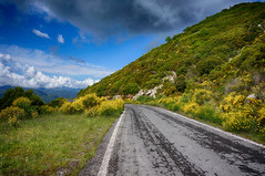going back (sugarfradivi) Tags: outdoor road hill landscape mountain ridge mountainside foothill colors colorful view blue yellow sky sony nex6 google nik greece greek nature flowers hdr efex peloponnese