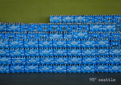 at the grocery today (dotintime) Tags: grocery display outdoor stack row pile water plastic bottle merchandise hot summer heat temperature sweat stock h2o dotintime meganlane