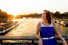 Gersende - On the Seine (Franois Escriva) Tags: paris france people woman pretty beautiful cute sun sky light clouds blue green yellow orange hair sunbeam sunrays rays bridge seine boat sunset