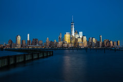 New York Blues (Ben-ah) Tags: hudsonriver sunset bluehour architecture ny newyork manhattan lowermanhattan skyline blue newport nj river wtc wfc worldtradecenter worldfinancialcenter batterypark