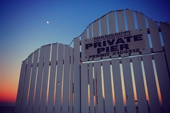 my own private twilight (jeneksmith) Tags: uninvited trespassing seaside passchristian mississippi sky moon sign gate gloaming dusk twilight beach hff fence pier canon
