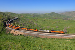 Orange with a touch of gray (Moffat Road) Tags: bnsf intermodaltrain locomotives spring grass hills tehachapipass bealville california dpu ge train railroad ca trainsmeeting meet curves orange