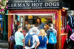 Hooray for Hot Dogs (garryknight) Tags: coventgarden hooraysgermanhotdogs lightroom london nx2000 ononephoto10 samsung food frankfurter hotdog market people queue stall stallholder