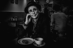 I know what it's like to be lonely too (sophie_merlo) Tags: bw blackandwhite mono monochrome sad lonely alone depression mentalhealth cafe eating street london man male guy hat glasses meal people indoor grain dark noir