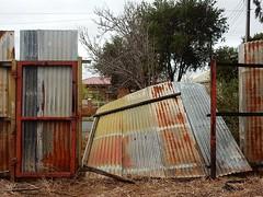 Wobbly Rust (mikecogh) Tags: kilkenny fence broken sheets damaged corrugatediron rust