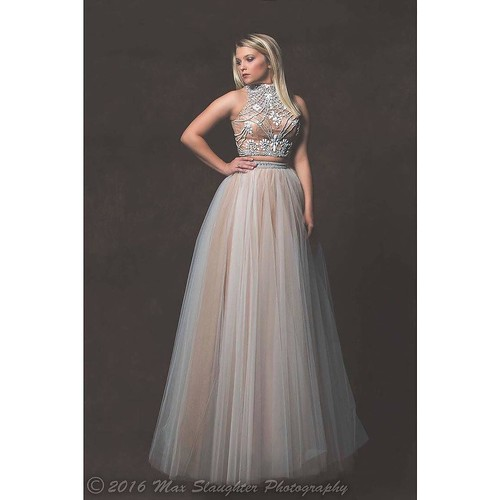 Splendid Miss Jazmin looks exquisite and a mile tall in this formal dress.