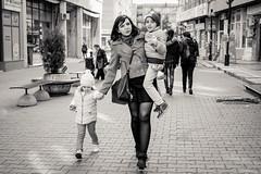 mother (Lev Maglev) Tags: kids mother single street alone blackwhite joy life people walking children