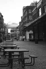 Empty benches (ashley.coventry) Tags: street nyc blackandwhite white black empty sony south tourist southstreetseaport alpha benches deserted bnw pathway seaport bdub nex nex6