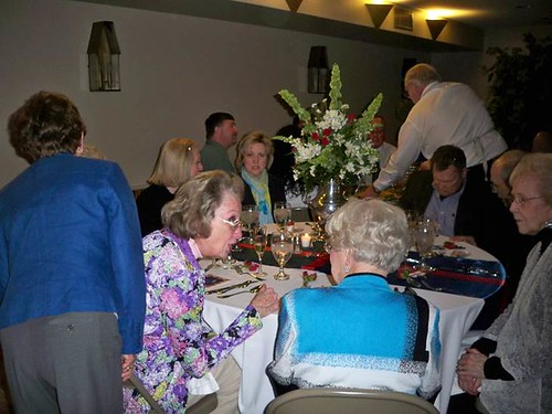<p>Parker Boggs assisting guests at one table.</p>