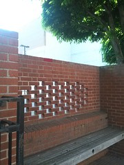 Another brick in the wall - crochet brick at bench/wall (hijennybrown) Tags: west brick wall bench graffiti virginia downtown crochet yarn wheeling yarnbombing