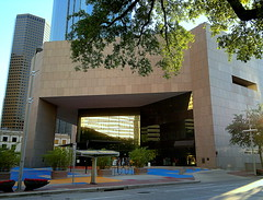 Houston Library - Downtown Branch (elnina999) Tags: park plaza new city travel blue trees windows sky urban panorama cloud reflection building cars window glass lamp skyline architecture modern skyscraper fence buildings circle corporate drive office high highway downtown day commerce cityscape texas exterior view traffic cloudy district famous platform houston sunny landmark center panoramic business round infrastructure metropolis tall shape finance nikond5100