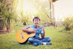 portrait of guitar (kennymuz) Tags: wood boy sunset musician music playing grass guitar young recital enjoy instrument acoustic string