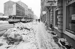 Rga 26 (Vygintas R.) Tags: 2011 bw juosta ryga rga 0046n11 film city street latvia january bessal kodaktmax400 kodak400tmax 35mmfilm nikoncoolscan5000 voigtlandersnapshotskopar25mmf40 iso400 winter snow streetcar tram building ice lenscorrection