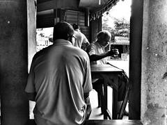 Morning in a Teashop (arkamitralahiri) Tags: india kolkata westbengal calcutta northcalcutta streetphotography streetscene street people faces outdoor blackandwhite monotonemonochrome culture teashop tea cellphone motorolag4plus everyday autofocus drink refreshment table urban city town metropolitan