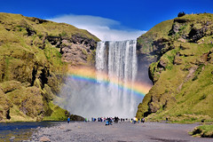 Waterfalls dressed that day his best rainbow (Sizun Eye) Tags: skgafoss waterfall sunny rainbow arcenciel tourists clouds falaise mountains river iceland islande northerneurope europedunord europa sizuneye sizun nikond750 d750 tamron2470mmf28 tamron 2470mm