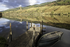 4 (paul wardropper photography) Tags: reflections boat jetty scotland wood hills sky posts rope nikon d40 calm serene mojo composition landscape afternoon