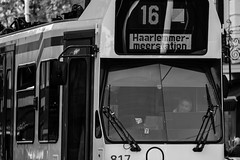 To Haarlem with a smile (John fae Fife) Tags: tramlines noiretblanc netherlands monochrome streetscene bw tramdriver blackandwhite nb amsterdam streetphotography