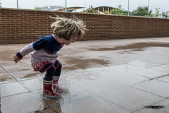 Loving Charcos...:) (rafagomezz) Tags: baby girl charco jumping enjoying water puddle saltando nia blonde cutie cute action playing kids autum otoo botas rojas boots red