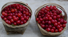 Cherries for sale on the market (Rita Willaert) Tags: china handicraft indigo skirt guizhou anshun southwestchina buyitribe villageshitouzhai