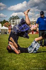 Frazer Hirsch in flight (FotoFling Scotland) Tags: scotland kilt scottish event wrestlers highlandgames meninkilts georgereid scottishbackholdwrestling fraserhirsch bearsdenmilngaviehighlandgames2013