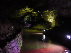 Entrancing Entrance (Alan FEO2) Tags: poolescavern buxton derbyshire underground tunnel cave indoors lights colours reflections dark shadows entrance floor water panasonic dmc g1 2oef