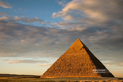 Sunset at the Chephren Pyramid, Giza, Cairo, Egypt (Nick Brundle-Photography) Tags: africa ancient ancientegyptianculture ancienthistory antiquities archaeology architecture cairo capitalcities city cityscape cultures dusk egypt egyptianculture egyptiandynasty giza gizapyramids history internationallandmark khafre looking manmadeobject mausoleum middleeast northafrica oldruin outdoors pharaoh photography pyramid pyramidofchephren pyramidofmycerinus shrine sideview silhouette skyline skyscraper sun sunlight sunset templebuilding thepast thesphinx tomb tradition tranquility transportation travel traveldestinations twilight unescoworldheritagesite yellow