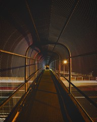 Stomping grounds (Blockshadows) Tags: 5dmarkiv wideangle lighttrails longexposure colorado denver toned tone tones shadows dark nightphotography night outdoors urban city i25 walkway highway symmetry tunnel bridge