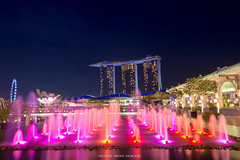 THE MARINA BAY SANDS WITH COLORFUL FOUNTAINS IN FOREGROUND (::: a j z p h o t o g r a p h y :::) Tags: singapore singaporeflyer marinabay fountain colorful outdoors night nightscape nightphotography nighttime nightlight travel tourism touristattraction touristdestination