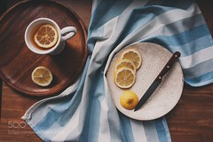 hot tea with lemon slices on wooden table, top view (SeattleHVAC172) Tags: yellow cup morning winter vintage health lifestyle white home healthy still life tea knife interior lemon mug hot drink plate wooden tone comfort enjoy cut cozy 500pxgetcozy stilllife