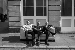 three lads and a sofa (Silver Machine) Tags: andover hampshire streetphotography street streetportrait men sofa sitting smiling blackwhite bw mono monochrome fujifilm fujifilmxt10 fujinonxf18mmf2r