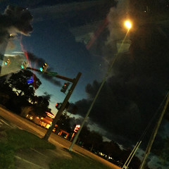 Menacing Sky (soniaadammurray - On and off will try to keep up!) Tags: digitalphotograph nighttime sky clouds driving road nicewonderfultuesdayclouds martesdenubes martedidinuvole streetscene lights reflections roads givemefive