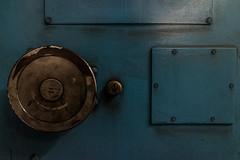 Smiley Face - Submarine Door (MoreToJack) Tags: victorialine londonunderground doors submarine kingscrossstpancras stpancras handle lu door platform underground london tube kingscross railway room station metal