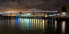Bay Bridge in Night from Downtown San Francisco Night Walk, California, USA (takasphoto.com) Tags: 20mm a6300 apsc apscexmorrbsicmossensor america bionzx bionzximageprocessor bayarea businessdistrict california californiastate cropsensor dark darkness downtown downtownsf downtownsanfrancisco emount eeuu estadosunidos fixedlens highiso ilce6300 lens lowlight mirrorless mirrorlessinterchangeablelenscamera night nightview nobhill noche noite norcal northamerica northerncalifornia nuit phasedetectautofocus photography primelens sel20f28 sfbay sfbayarea sanfrancisco sanfranciscobayarea sanpancho sony sonysel20f28emount20mmf28primefixedlens sonya6300 sony6300 street streetphotography time usa unionsquare unitedstates unitedstatesofamerica westcoast wide widelens wideview reflection water waterfront