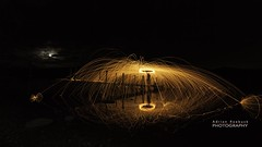 Sparks and Moon (Buck_68) Tags: lakedistrict ashness jetty derwentwater lakes lake fire sparks monn moonlight night dark reflection heat circles arc arcs reflecting mirror black orange spin