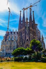 Sagrada Familia (Alessio Catelli) Tags: sagrada familia barcellona barcelona spain spagna sky clouds church chiesa famous water trees fuji xe1 xf1855