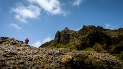red runner (soundmoods) Tags: tenerife rocks sky blue red clouds sunny jogging climbing rough landscape
