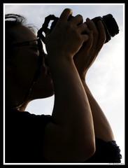A girl with a camera (Pierluigi Mozzano) Tags: light shadow portrait woman girl face silhouette donna nikon ombre nikkor ritratto luce viso ragazza fotografa 1870 d300