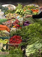 Transaction (Andrew Tan 2011) Tags: money vegetables tomato market sale lettuce malaysia carrot deal cauliflower peppers chilly bittergourd lime sell brinjal longbeans spinach kota turnip chillies kelantan transaction springonion bharu leafyvegetables sitikhadijahmarket