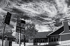 Thru another town (citrusjig) Tags: sky bw wisconsin work spring driving pentax driveby signage infrared toned manualfocus kx clearglass blackearth fullspectrum zenitar16mmf28 converteddslr bw090redfilter ruralworld