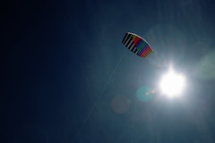 Let's go... (Grifmo) Tags: blue sky sun kite flying high rainbow lensflare