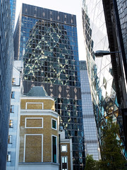 'The Gherkin' (davepickettphotographer) Tags: city uk travel windows london tourism glass 30 skyscraper photography office olympus gb axe gherkin offices bishopsgate towerhill thegherkin westminister stmarys em1 olympuscamera ec3a cityofwestminister 8ep