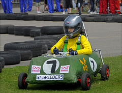 100626.063. #7 St Peter-in-Thanet. (actionsnaps) Tags: girls green boys ecology yellow youth racetrack children kent gloves overalls sns schoolchildren recycling visor steeringwheel seatbelt pupils teammates teamwork coveralls ramsgate safetyharness protectiveclothing circuitrace kitcars learningexperience grasstrack oldtyres safetyhelmet groupactivity environmentalstudies primaryschools interschoolcompetition fullfacehelmet usedtyres ecoscience homemadecars drivershelmet structurednetworksolutions stpeterinthanetchurchofenglandjuniorschool bestbodyworkdesign chathamhousegrammar juniorscienceandtechnologyengineers batterycargrandprix