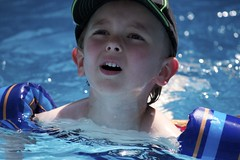 Cousin (powersmatthew17) Tags: summer funnyface cute water swimming children kid funny child floaties oldpic