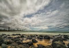 Hi-rise horizon (BAN - photography) Tags: ocean longexposure sea clouds sand rocks shore beachfront hirise