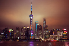 Shanghai at Night (laskaproject) Tags: china city longexposure sky tower architecture night clouds river lights skyscrapers shanghai metropolis