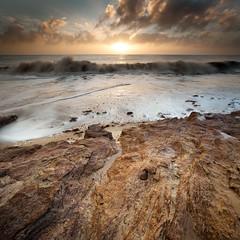 Break (jellyfire) Tags: winter sea tourism beach sunrise canon square landscape dawn coast suffolk sand general unitedkingdom shoreline cliffs erosion clay environment southwold eastanglia crepuscularrays benacre covehithe coastalerosion canon5dmkii zeissdistagont18mmf35ze